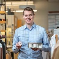 Image of Prof. Zac Hudson holding sustainable coffee pods